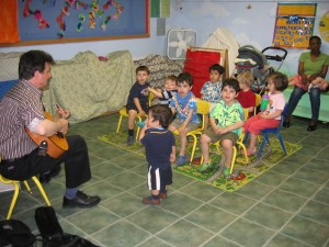 Music teacher singing with children