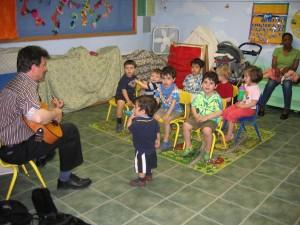 Music teacher singing with children