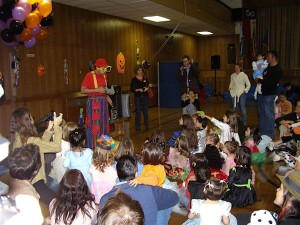 a large crowd at a PAA Halloween party